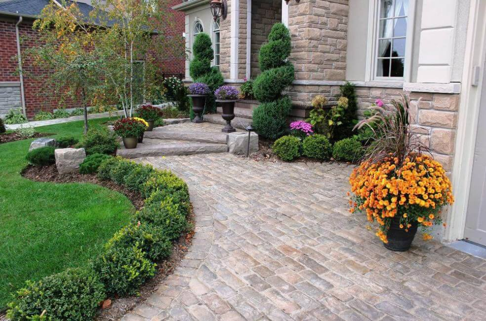 Structured Evergreen Garden Remodel Beds With Colorful Planters